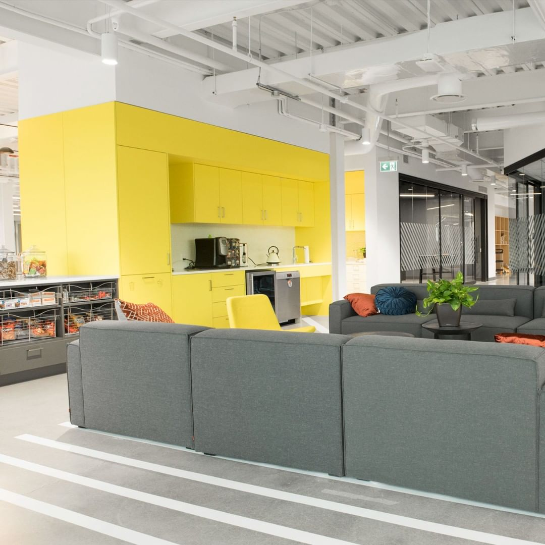 HealthHub's R&D Innovation office open workspace area with sofas