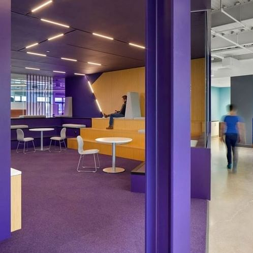 A purple open workspace room in HealthHub's R&D Innovation office